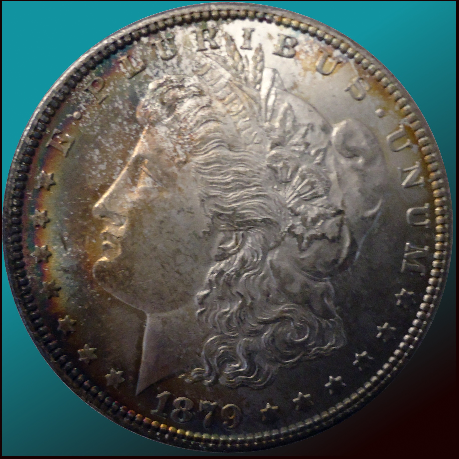 1879 Morgan S raw with toning